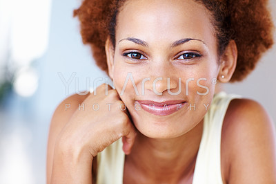 Closeup portrait of a cheerful woman lying on her lounge floor
