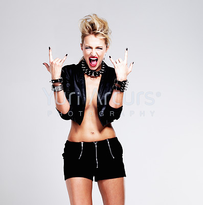 Portrait of funky woman in punk mood over white background